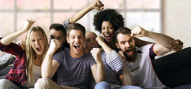 group_cheering_gray_sofa